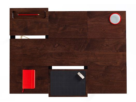 rican black walnut worktop is held up with brass plate bracings and specially designed steel legs that enable both high and low desk options.