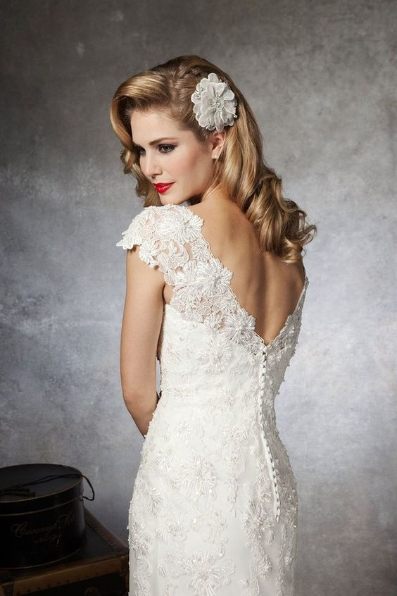 LOVE this wedding gown for a spring wedding! #weddinggowntips #laceweddinggowns #weddinggownideas