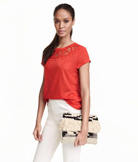 Check this out! Top in a fine knit with linen content. Short sleeves and decorative lace section at neckline. - Visit hm.com to see more.