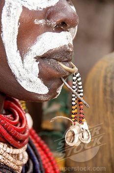 Africa   Detail of a Karo woman's face with tongue piercing and a nail in the lip, Omo river valley, Southern Ethiopia  ©Age fotostock
