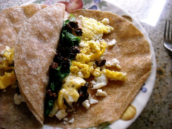 Greek Breakfast Burittos(2 wheat tortillas  3 eggs,1 tbsp milk ,Feta cheese,3 large chopped sundried tomatoes,1 cup fresh spinach,Pepper and salt)