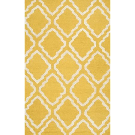 Lend a pop of pattern to your entryway or master suite with this hand-woven wool rug, featuring a trellis motif in gold.  Product: