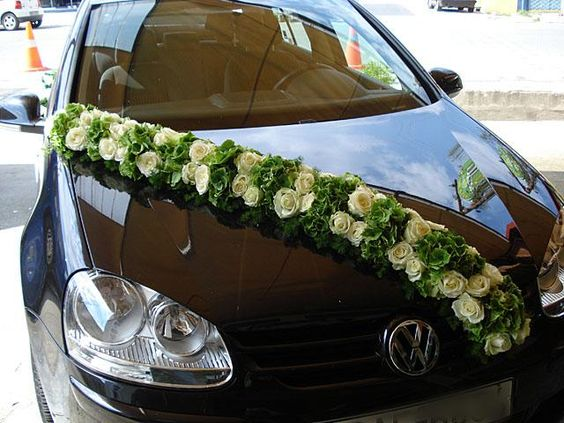 K'Mich Weddings in Philadelphia PA - wedding planning - wedding decor - limo decor - Jetta with floral on the hood
