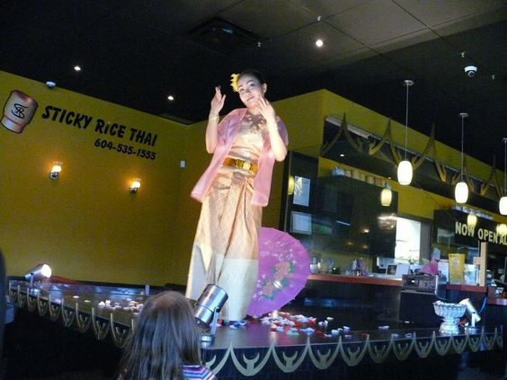 Apinya performing a Thai Dance called the Umbrella Dance at the Sticky Rice Thai Cuisine Restaurant.  Presented by www.bcrestaurants.ca / www.ecomcreator.com