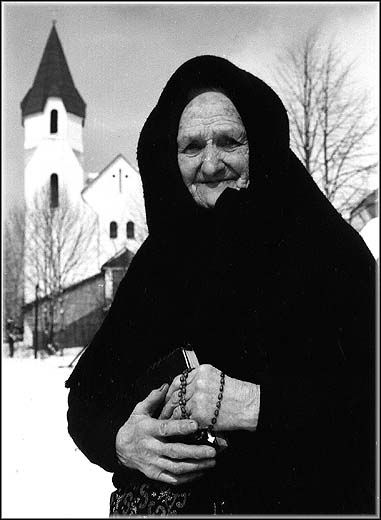 slovak woman going to church
