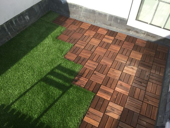 Roof terrace with ikea decking tiles and oakham artificial for Garden decking and grass
