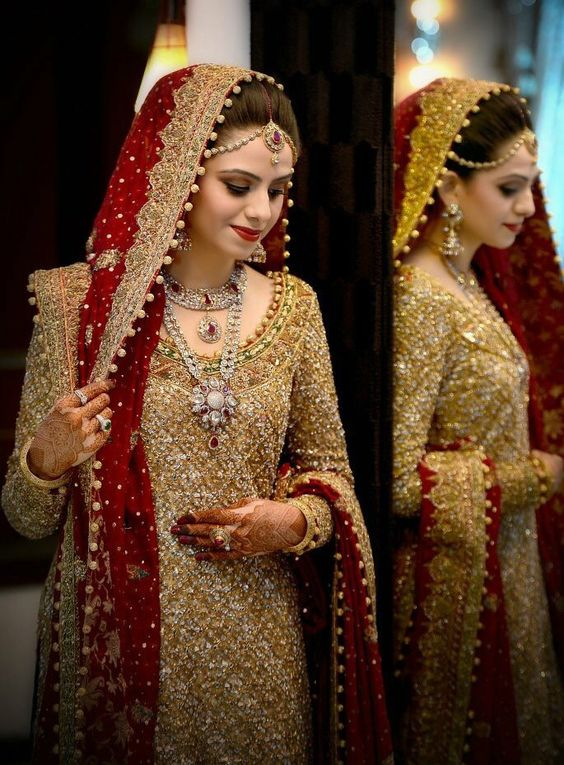 Glamorous red and golden combination for brides
