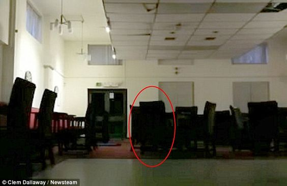 Is this Britain's grumpiest ghost? Worker sets up secret filming after strange goings-on at community centre and captures door slamming, a chair moving and the hidden camera being pushed over