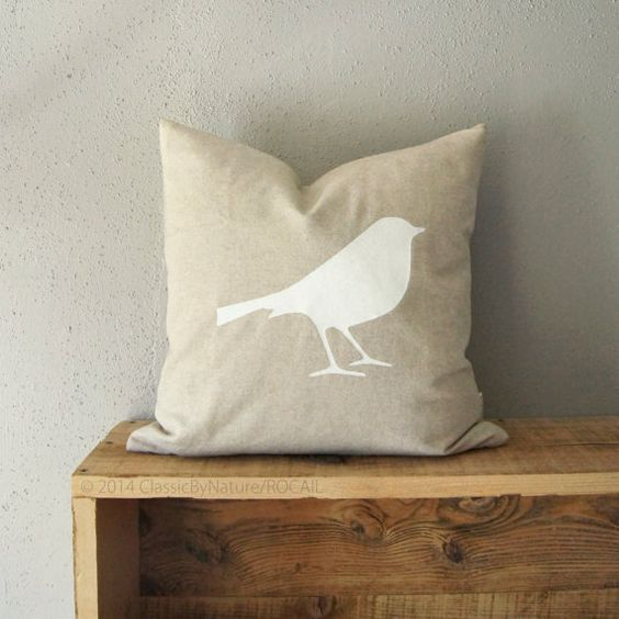 This is a 16 x 16 decorative pillow cover with a lovely white bird silhouette hand screen-printed on a natural beige background. The bird print