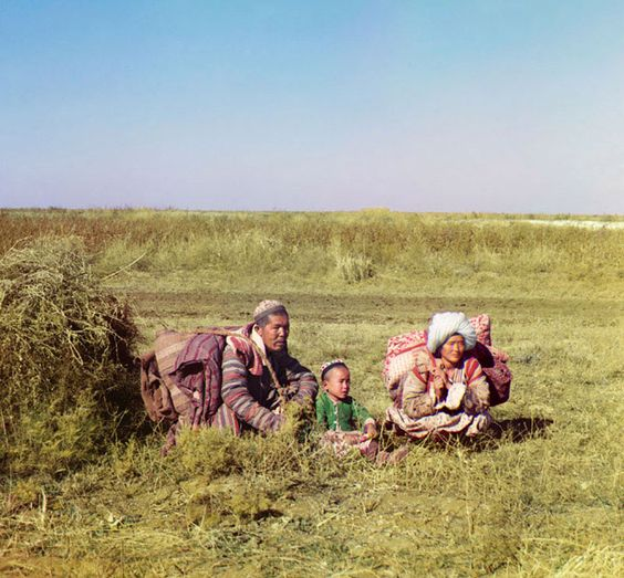 Nomadic Kazakhs on the Steppe, 1911    Many Central Asiatic peoples, for example the Kirghiz, Kazakhs, and Uzbeks, lived nomadic lives on the steppes, valleys, and deserts, migrating seasonally from one place to another as opportunities for obtaining food, water, and shelter changed. Shown here is a young Kazakh family in colorful traditional dress moving across the Golodnaia (or 'Hungry') steppe in present-day Uzbekistan and Kazakhstan.