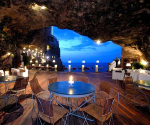 sea cave restaurant in southern italy. Tucked away in a cavernous sea grotto in Grotta Palazzese Hotel's fine cuisine restaurants.