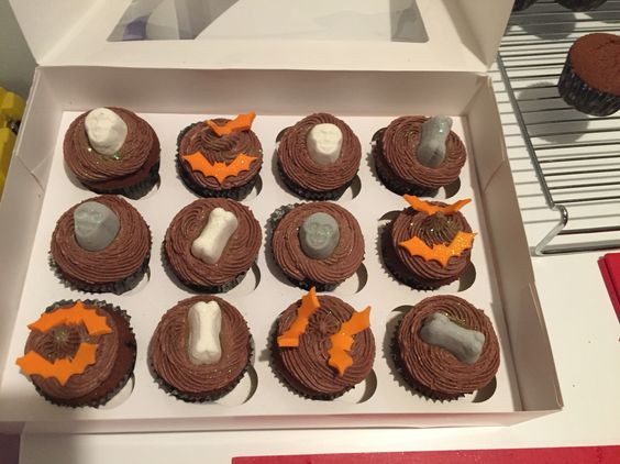 Homemade Halloween double chocolate cupcakes with marshmallow skulls and bones and fondant bats