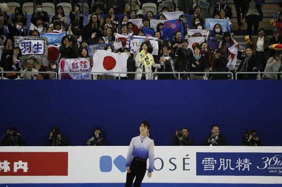 Yuzuru Hanyu of Japan performs during the Mens Short Program event in the ISU World Figure Skating Championship 2015 held at the Oriental Sports Center in Shanghai, China, Friday, March 27, 2015. Hanyu finished in first place in the event. (AP Photo/Ng Han Guan)