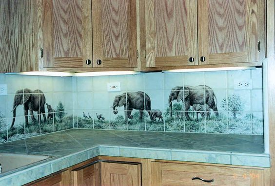 """Vanessa's East Africa""  African East Africa wildlife scenes in a California kitchen.  The scenes below are sections of a very large (16 foot long) tile mural.  Custom designed decorative backsplash mural on kitchen tile.  Hand painted on 6 x 6 inch ceramic tile."