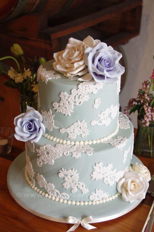 Pale mint round wedding cake with custom sugar roses.