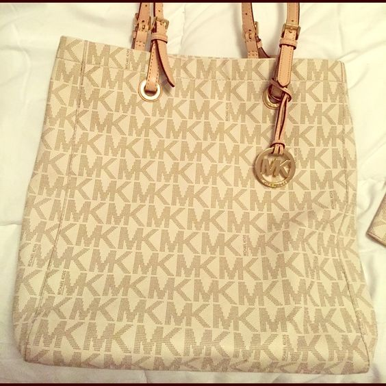 Mk tote and wallet combo Lightly worn purse with strap tear, wallet like new Michael Kors Bags Totes