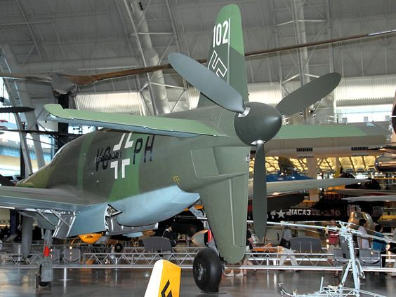 """Rear view of the Dornier DO 335 A-1 Pfeil. The Dornier Do 335 Pfeil (""""Arrow"""") was a World War II heavy fighter built by the Dornier company. The two-seater trainer version was also called Ameisenbär (""""anteater""""). The Pfeil's performance was much better than other twin-engine designs due to its unique """"push-pull"""" layout and the much lower drag of the in-line alignment of the two engines."""
