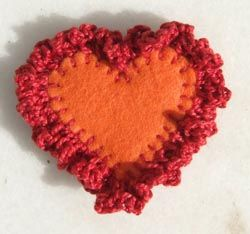 Felt and crochet heart.   Over dyed crochet cotton, roving & buttons for an embellished pincushion/orn. 4 & 5 chains instead of the suggested 3. Will use again.