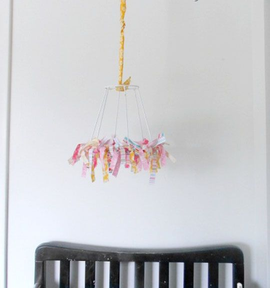 DIY fabric scraps mobile (add hanging birds to the bottom?) | via Apartment Therapy.