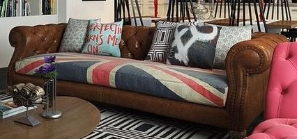 Buy leather-looking couch and reupholster cushions to fabric