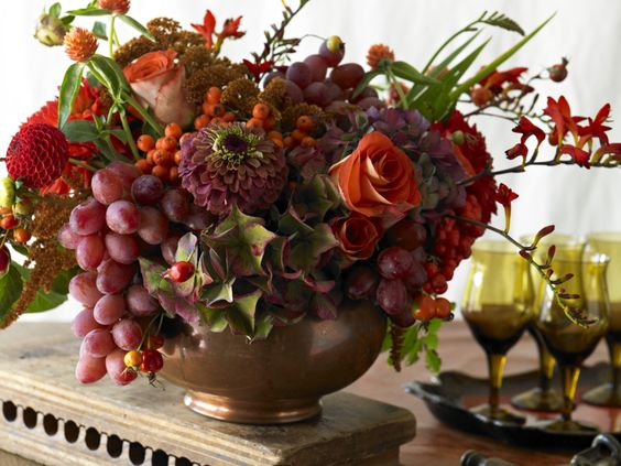 Red Grapes From California Add Fullness And Beauty To This Fall Colored Flower Arrangement