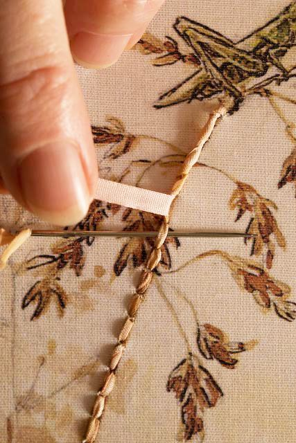 wrapped backstitch, using silk ribbon. clever.