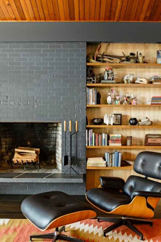 painted brick grey walls medium wood ceilings and light wood book shelves built in!