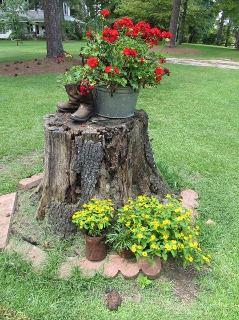 decorating a tree stump with flowers and yard art just