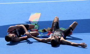 Alistair (left) and Jonathan Brownlee (right) of Great Britain react after…