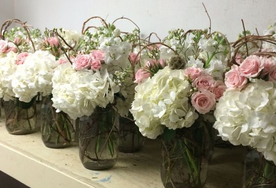 Mason jars with honeysuckle and flowers