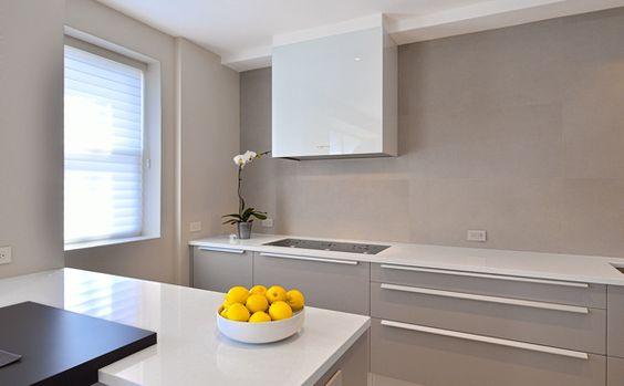 Pedini lacquer cabinetry, organic white quartz countertop, large tile backsplash, lemons