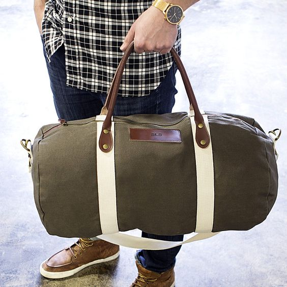 This quality green duffle bag measures 22 inches long by 11 inches wide by 11 inches high, and has two leather carrying handles measuring 20 inches long.