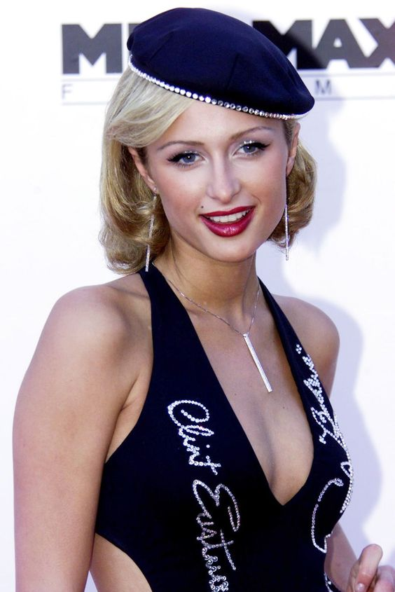 Berets, ThenParis Hilton's bedazzled beret was the epitome of It-girl status in the 2000s.  #refinery29 http://www.refinery29.com/glossy-lips-glitter-2000s-makeup-trends#slide-29