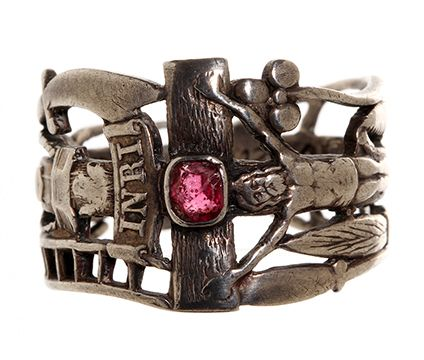 Early 19th Century reproduction of Katharina von Bora's wedding ring. Katharina and Martin Luther were married in 1525. In Sterling Silver with a natural Ruby. The imagery on the ring represents The Passion of Christ; the crucifixion and the instruments of torture.