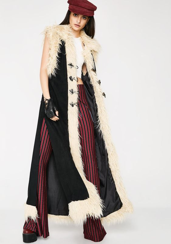 Current Mood Whirlwind Sleeveless Duster cuz you're a force of nature. This black duster has off-white faux fur trim, slits on the sides, and three toggle closures on the front. #Dollskill #Willow #Festival #FestivalDoll #FestivalGirl #FestivalStyle #Willow #Boho #Bohemian #Coachella #CoachellaStyle #BurningMan #BurningManStyle #Fringe #Bonnaroo #hippie #hippiegirl #psychedelic #hippiesoul #gypsysoul #gypsy