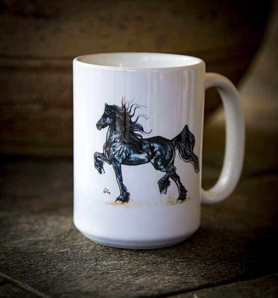 Have a smile with every sip with this wonderful Friesian horse mug. The mug is white ceramic with vivid watercolor artwork printed on the front. It holds 15oz of hot or cold beverages, is dishwasher a