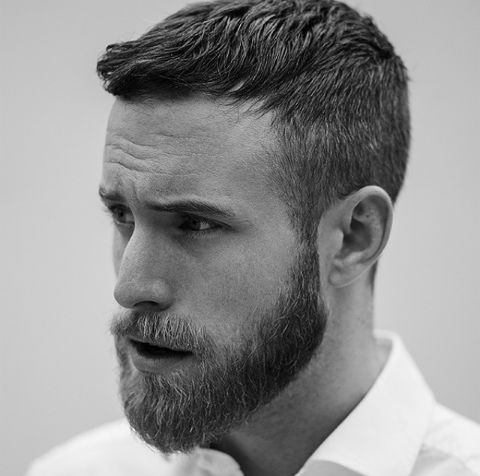 .NICE HAIRCUT WITH TRIMMED BEARD LOOKS VERY GOOD ON THIS GUY.