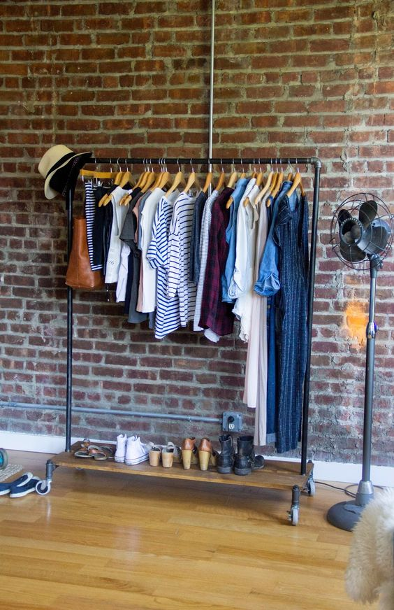 Clothes racks rolling clothes rack and loft apartments on for Apartment clothing