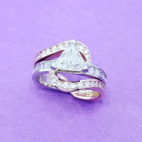 Trillion Cut Diamond set in a gorgeous Rose and White Gold. Sharon Oringderff