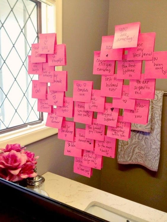 Heart notes on a mirror! Click through for 35 amazing, over-the-top Valentine's Day ideas, including Valentine's crafts, Valentine's recipes, and Valentine's decorations, and more!