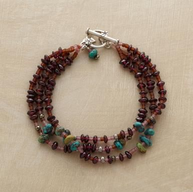 "Three richly colored strands with garnet, turquoise and pyrite dispersed among russet and rosy pink seed beads. Toggle clasp. Handmade. Exclusive. Approx. 7-1/2""L. $148.00"