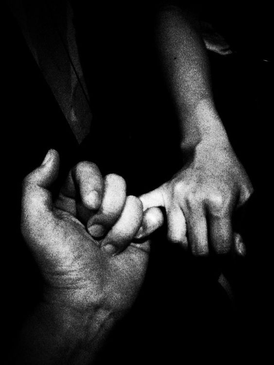 black and white clutching hands image