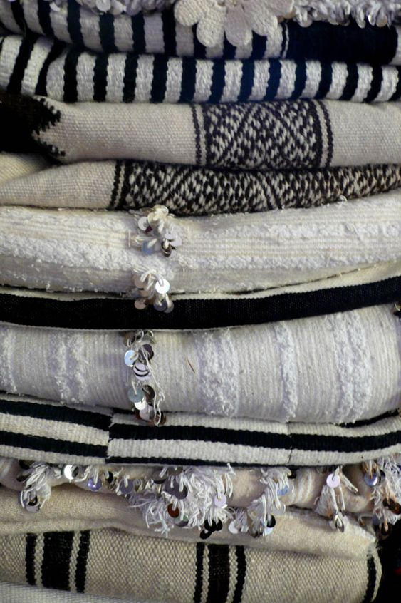 vintage cream, white, and black blankets from Mali and Morocco