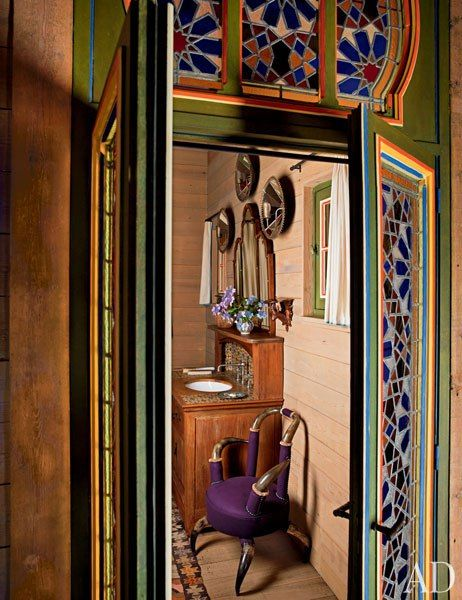 Stained-glass doors open to a powder room in Pierre Bergé's dacha in Normandy, France.
