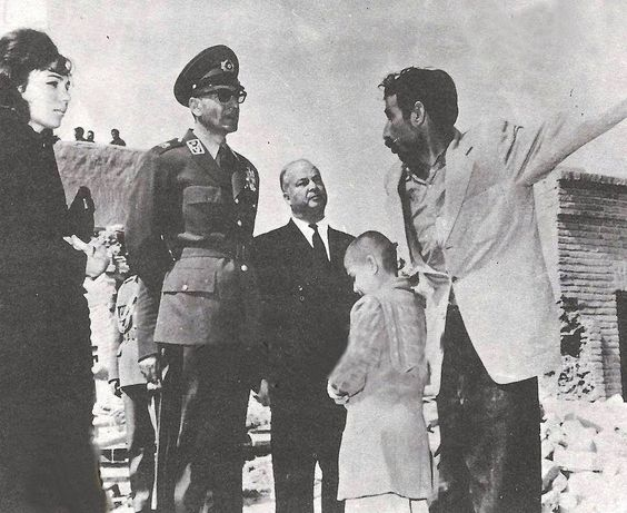 Mohammad Reza Shah and Empress Farah helping at a site of an earthquake in Iran.