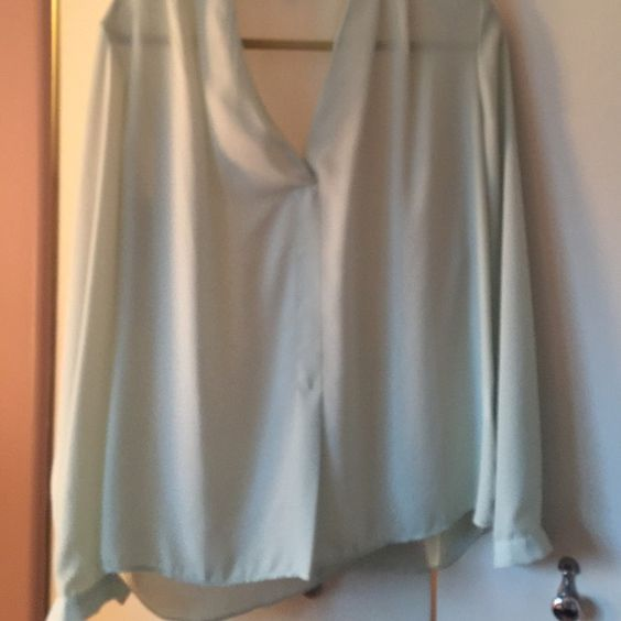 Long sleeve mint colored blouse Mint colored sheer long sleeved blouse.  Worn once Rose and olive Tops Blouses