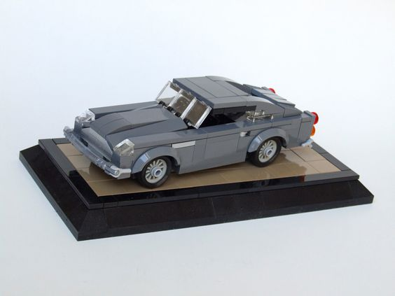 https://flic.kr/p/oDwdjn | Aston Martin DB5 | How did we get along without 1x2 and 2x2 curved slopes? I really don't know ... 6w+. Fits one whole minifig, wheels are spinning. 100% Lego. Thanks for looking!