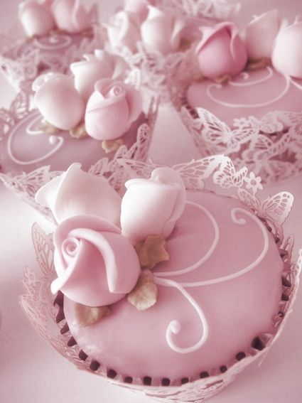 pink rose cupcakes with white lace butterfly holders
