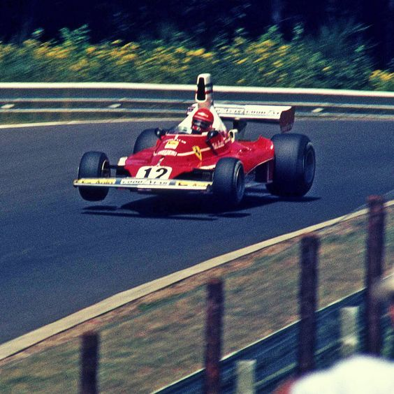 "Niki Lauda in his Ferrari 312T at the ""Pflanzgarten"" 1975. With his 6:58,6 minutes in pratice, he was the first driver to achieve a laptime under 7 minutes at the Nürburgring."
