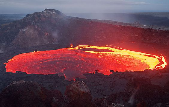 Lava lake inside Kilauea volcano, Hawaii | Lava lake inside Kilauea volcano's West Gap crater. The whole crust covering the lake has just been overturned, exposing the red hot glowing interior. Photography by Tom Pfeiffer